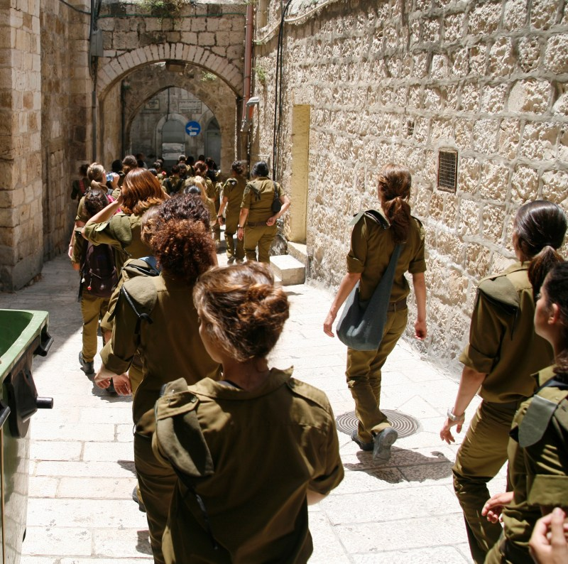 Army cadet class marches through Old City in Jerusalem after graduation ceremony.