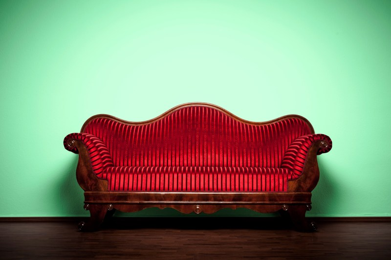 Photography of a restored Art Nouveau sofa.