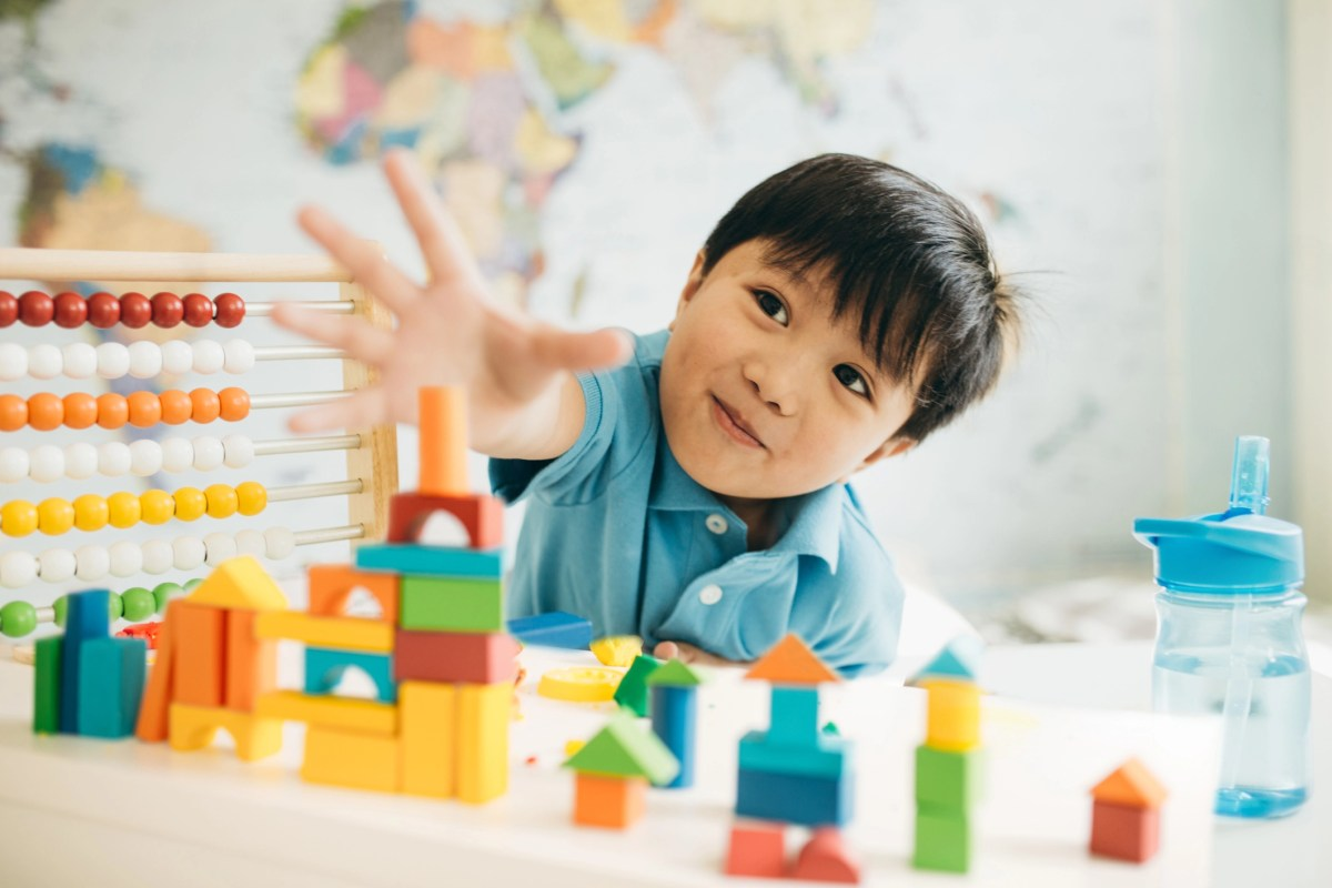 Cute toddler with wooden blocks