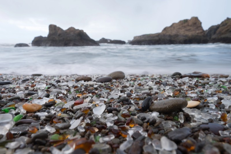 Beach made up of multicolored sea glass.