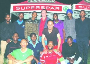 On the photo is the Superspar soccer league management team.