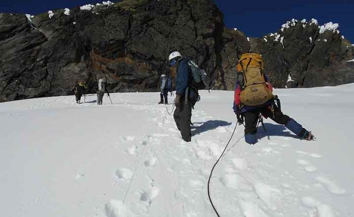 Climbers in deep Rwenzori snow+Uganda+travel_with+Kwez+Outdoors