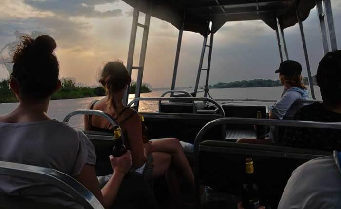Enjoy a sunset game cruise on the Nile as it leaves Uganda - travel with Kwezi Outdoors
