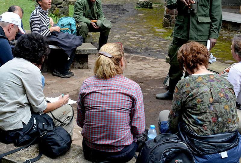 Journalists interview a Uganda Wildlife Authority ranger+travel with+Kwezi+Outdoors