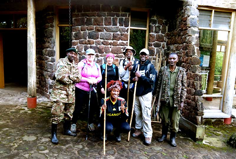 The climbing team with Uganda Wildlife Authority rangers at Mt. Mgahinga National Park headquarters before the hike