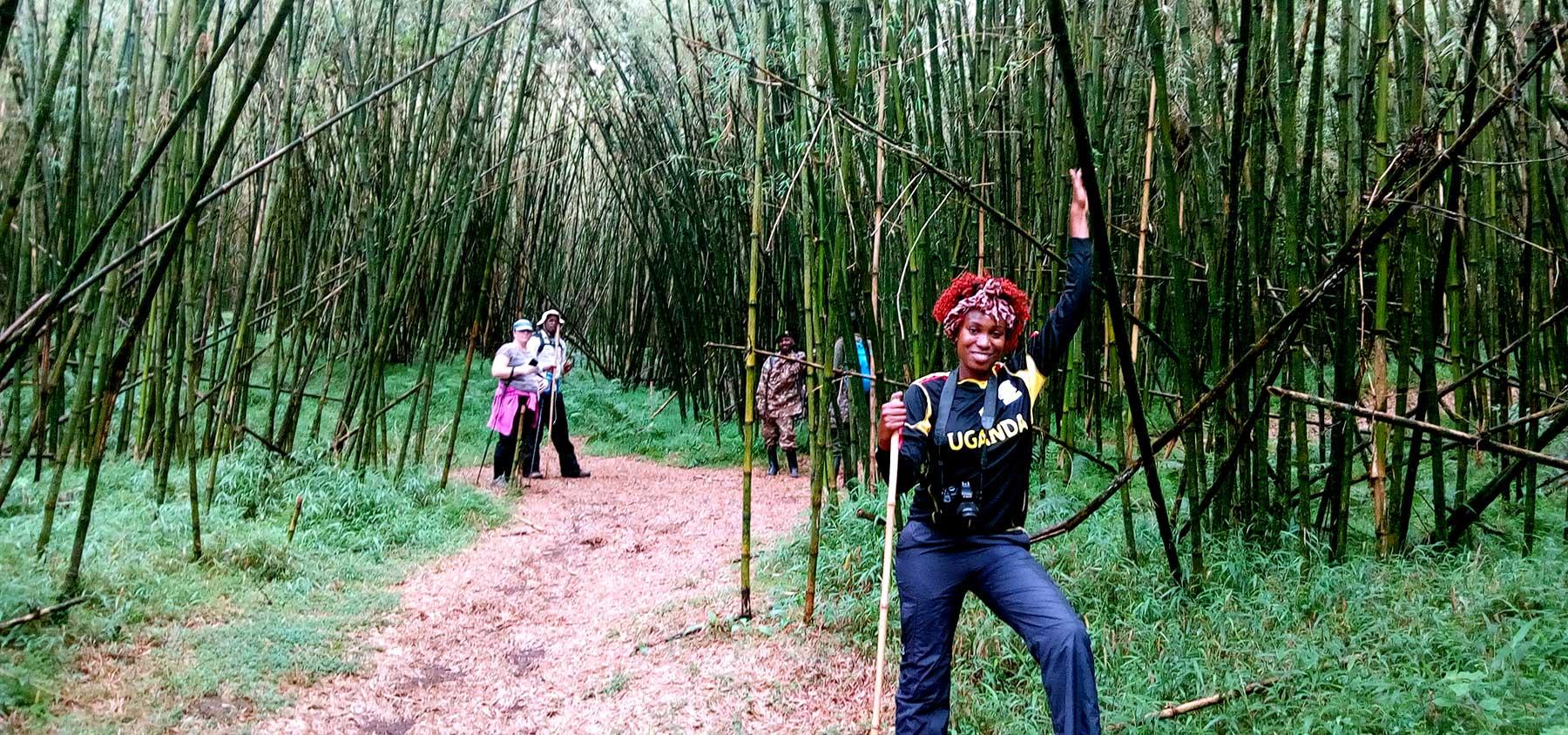 Lorna Paska on the trail up Mt. Mgahinga in Uganda. Take you hike safari with Kwezi Outdoors