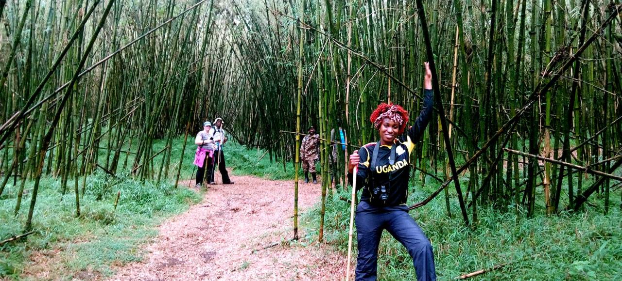 Lorna Paska on the trail up Mt. Mgahinga in Uganda. Take you hike safari with Kwezi Outdoors