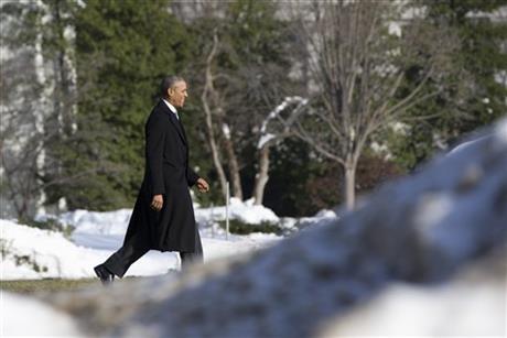 obama President Barack Obama walks past piled snow toward the South Lawn of the White House in Washington, Monday, Jan. 25, 2016, to board Mari_235468