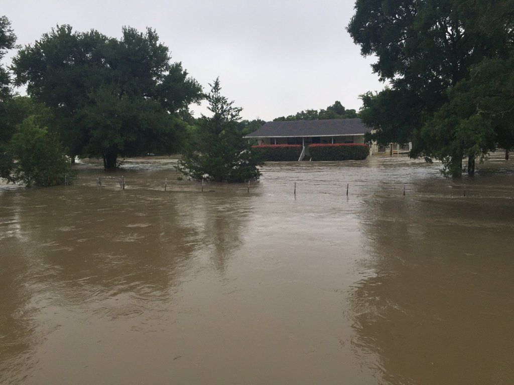 A flooded house near Thousand Oaks Dr. in Bastrop county. Neighbors shout _exact same thing happened last year.__291385
