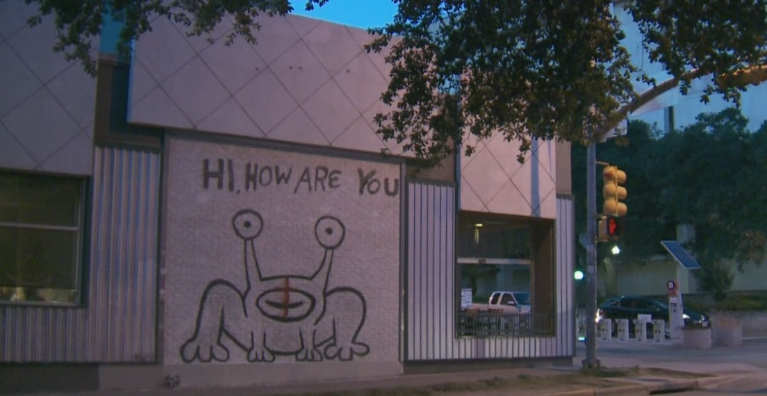 Hi How Are You mural vandalized with a red cross_317246