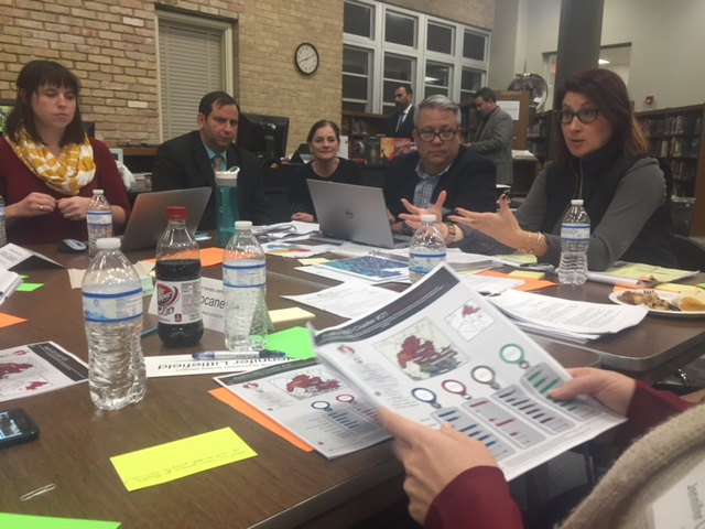 Members of the AISD Facilities and Bond Planning Advisory Committee going over school options_385219