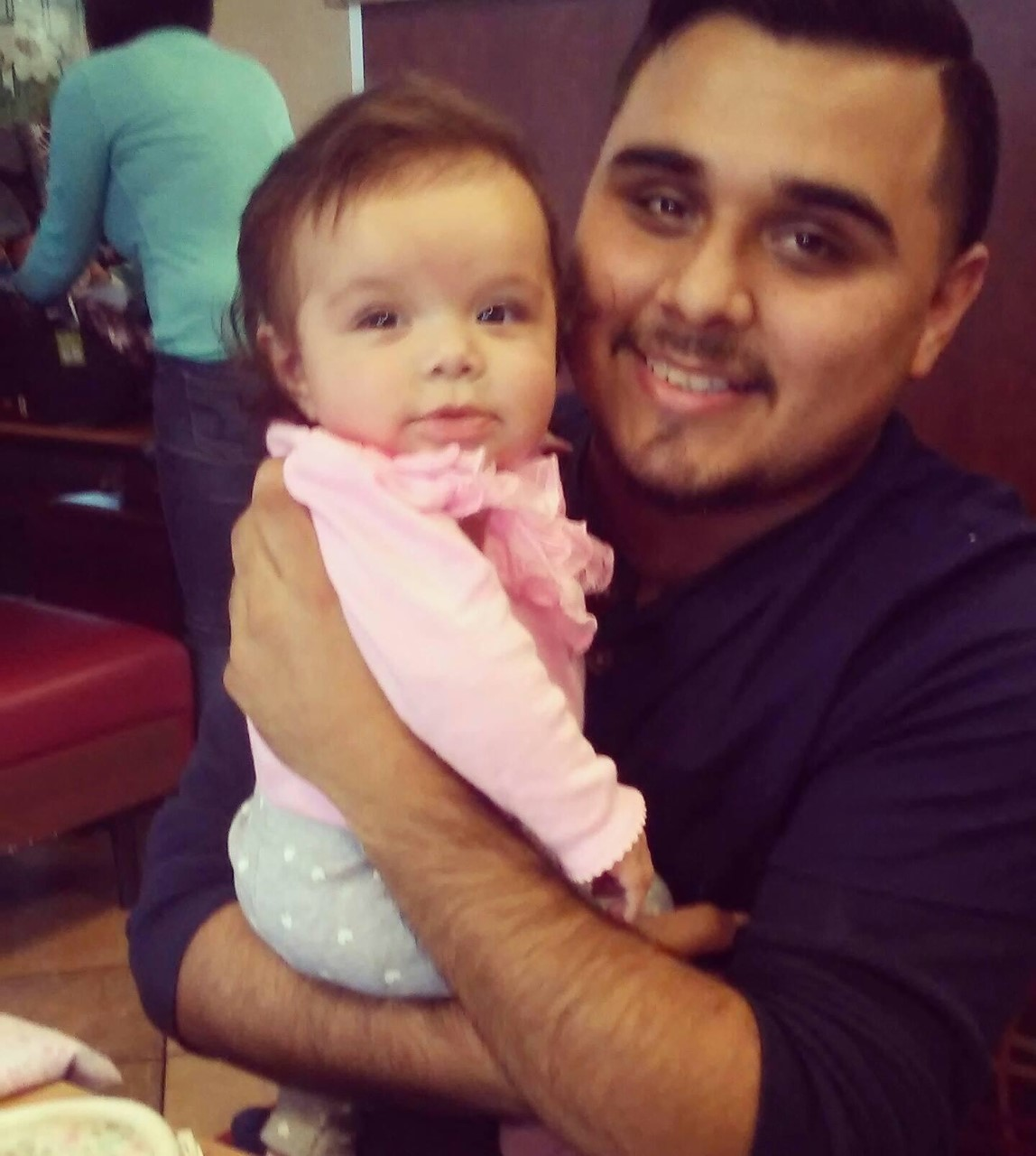 Joel Rodriguez and his two-month-old daughter_402225