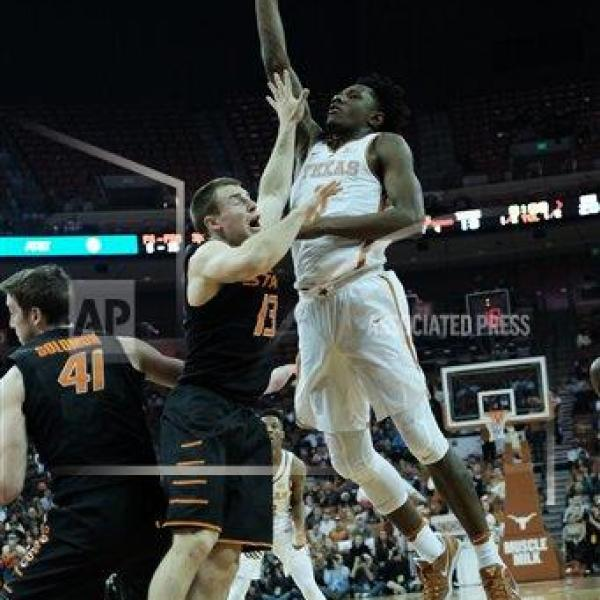 Jan 4, 2017.. Tevin Mack #0 of the Texas Longhorns in action vs the Oklahoma State Cowboys at the Frank Erwin Center in Austin Texas. Texas def_395517