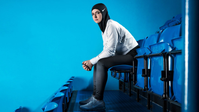 In this undated image provided by Nike, figure skater Zahra Lari model wears Nike's new hijab for Muslim female athletes. The pull-on hijab is _432775