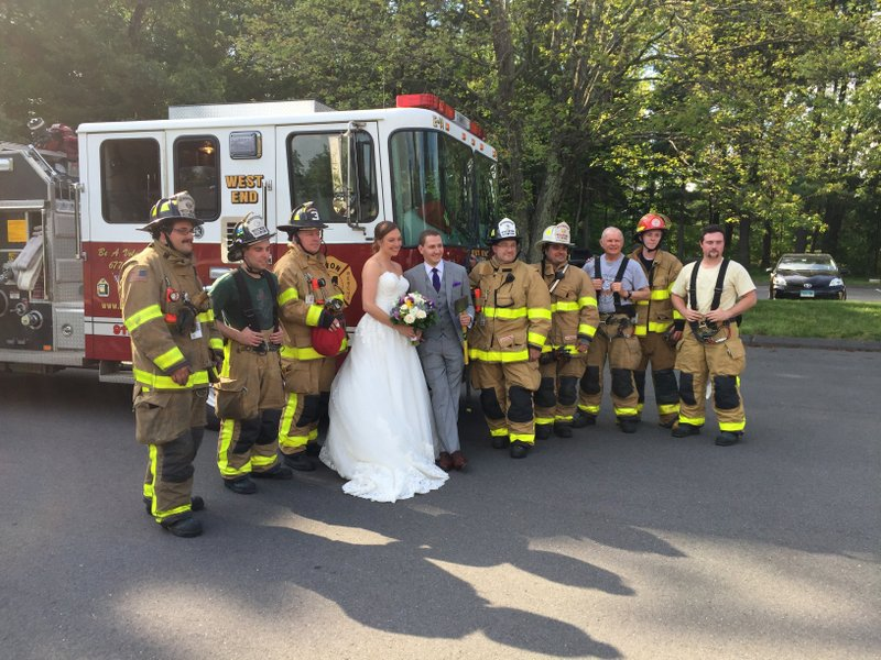This photo provided by Ken Sedlak, shows volunteer firefighters in Avon, Conn., posing with newlyweds Maria Leonardi and Justin Stone on Saturd_488120
