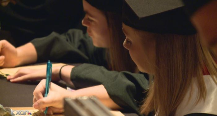 AISD grads signing up to vote after walking (KXAN photo)_482200
