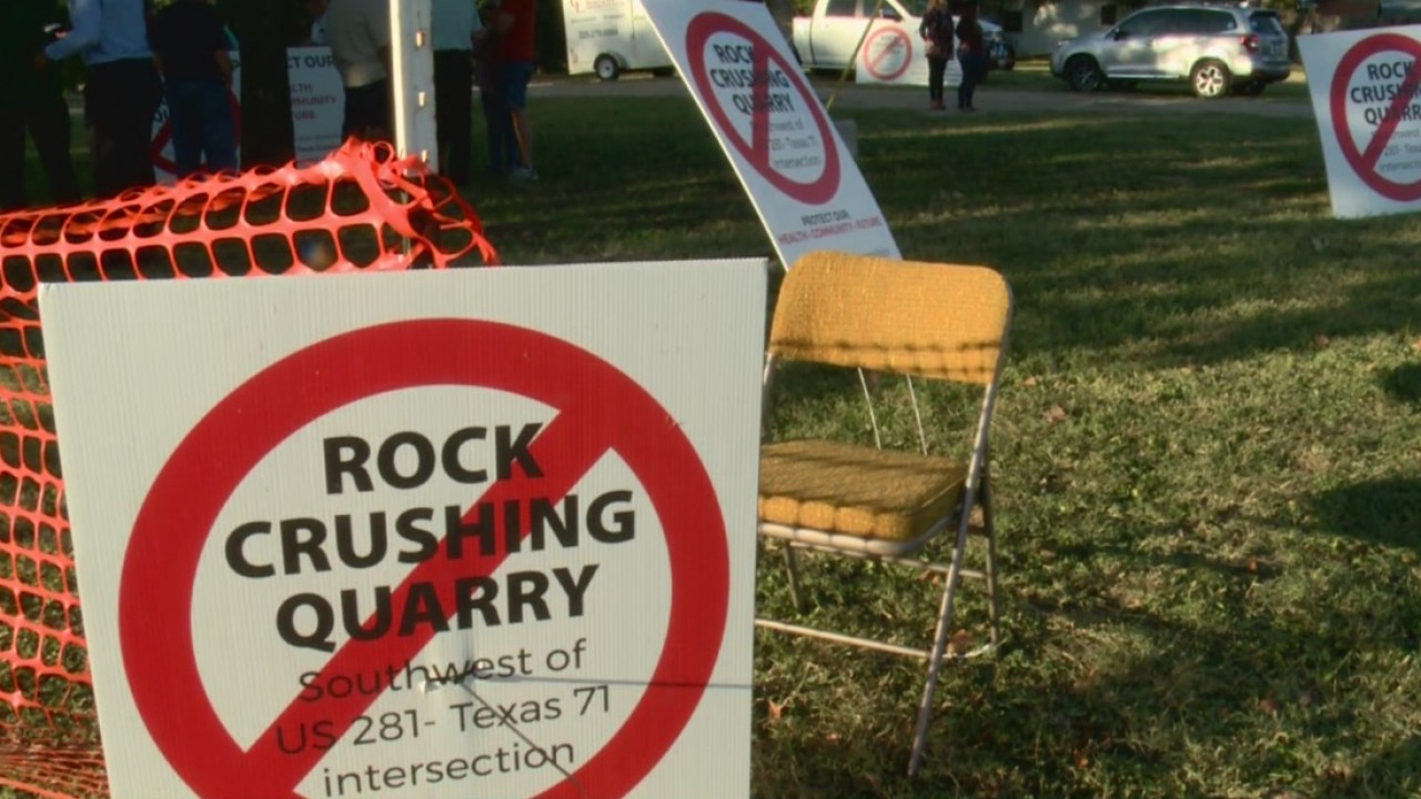 Protest signs against a proposed rock crushing quarry in Marble Falls_570051