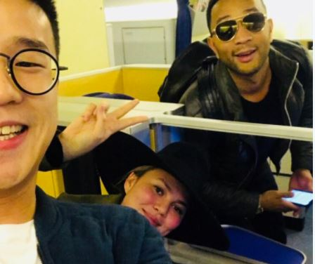 HIDDEN PIC - A passenger takes a selfie with Chrissy Teigen and John Legend after their flight was turned around due to an authorized person on_603991