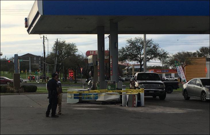 Car hits man and gas pump