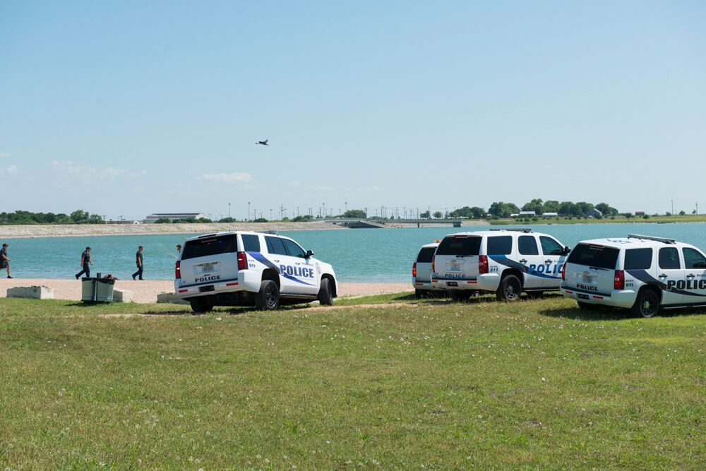 First responders search Lake Pflugerville for a missing swimmer