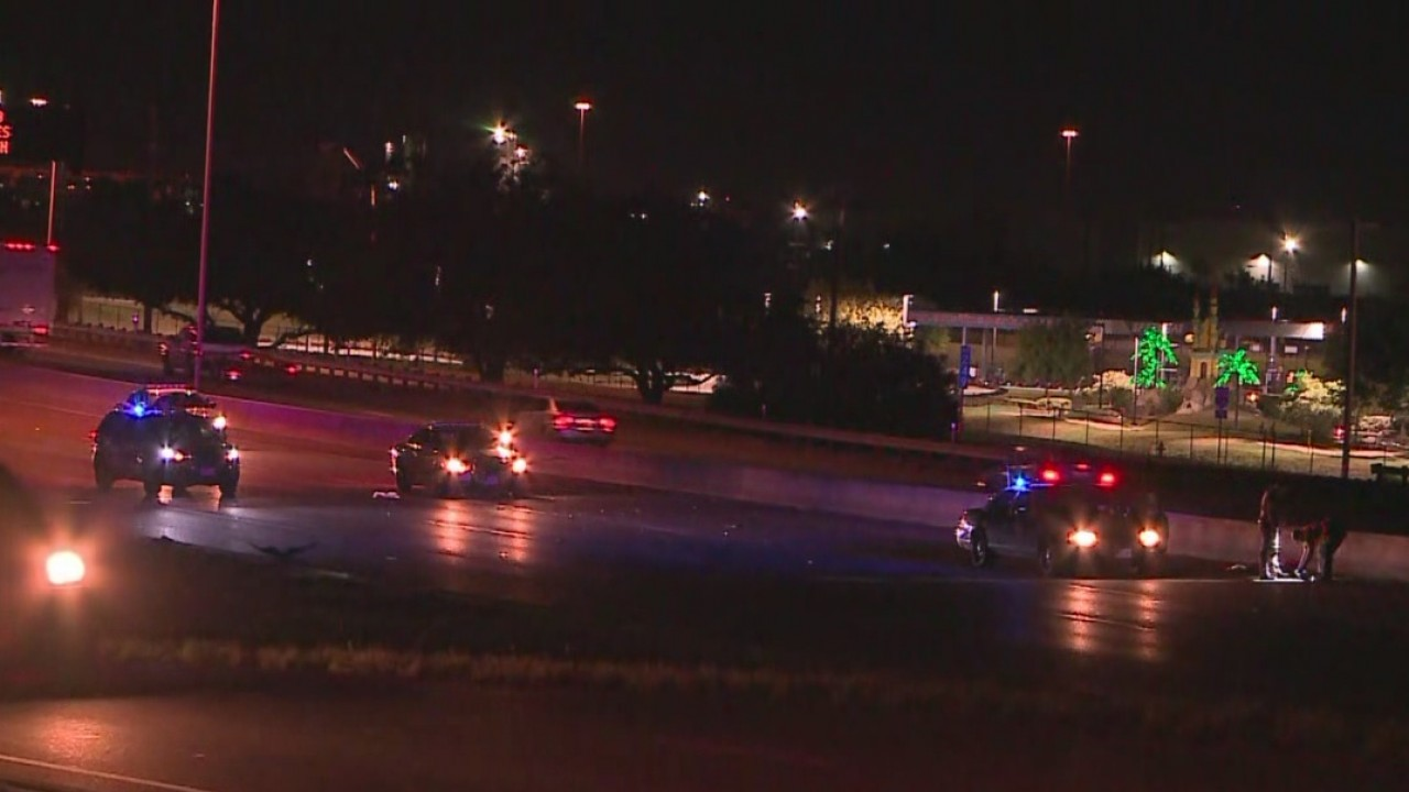 Law enforcement on I-35 near Grand Avenue Parkway where a pedestrian was hit and killed by a semi truck on Sept. 4, 2018