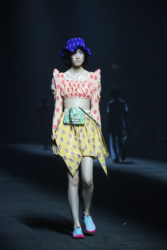 3bb14bf13a A model wears a creation for the Kenzo mens Spring-Summer 2020 fashion  collection presented in Paris, Sunday, June 23 2019. (AP Photo/Michel Euler)