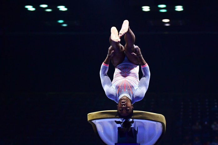 INDIANAPOLIS, INDIANA - MAY 22: Simone Biles lands the Yurchenko double pike while competing on the vault during the 2021 GK U.S. Classic gymnastics competition at the Indiana Convention Center on May 22, 2021 in Indianapolis, Indiana. Biles became the first woman in history to land the Yurchenko double pike in competition. (Photo by Emilee Chinn/Getty Images)