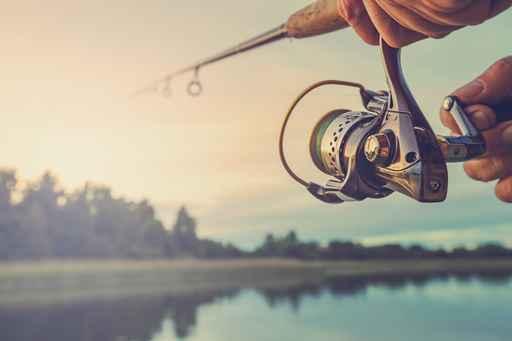 Fishing on the lake at sunset. Fishing background._1553099340231