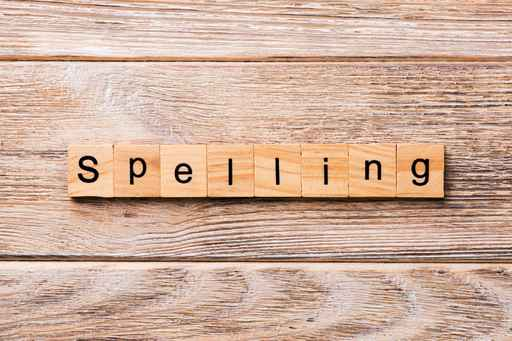 spelling word written on wood block. spelling text on wooden tab_1553090210562