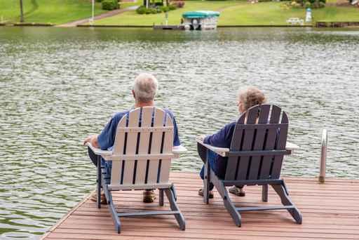A beautiful senior couple contemplates the future, sitting toget_1558019859029