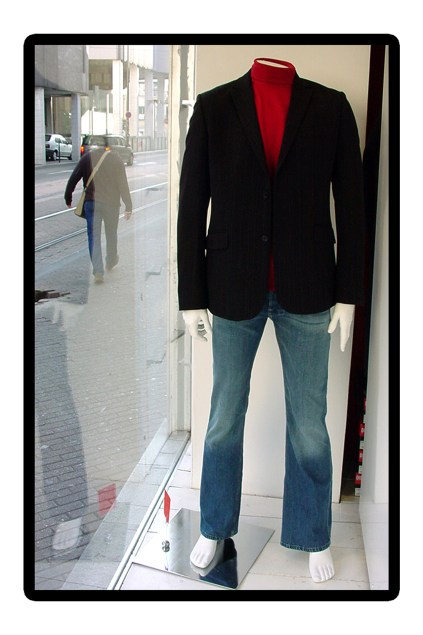 Photo montage of a casual street scene made strange with two mannequins by Kyesos