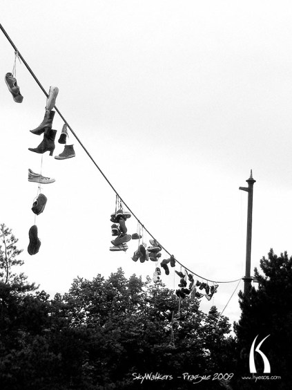 Shoes attached high in the sky in Prague