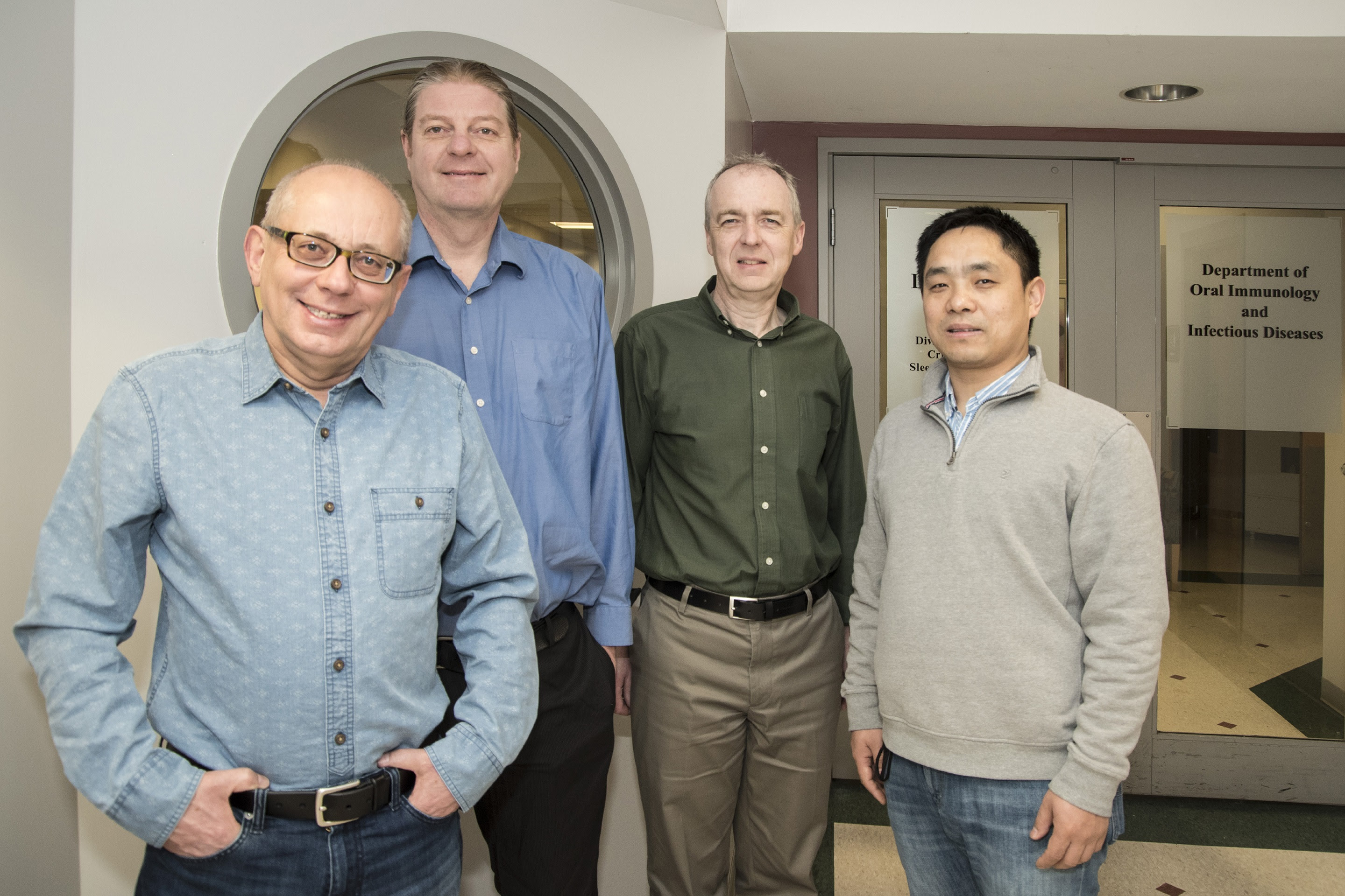 UofL School of Dentistry researchers Jan Potempa, David A. Scott, Richard J. Lamont and Huizhi Wang  (UofL Photo)