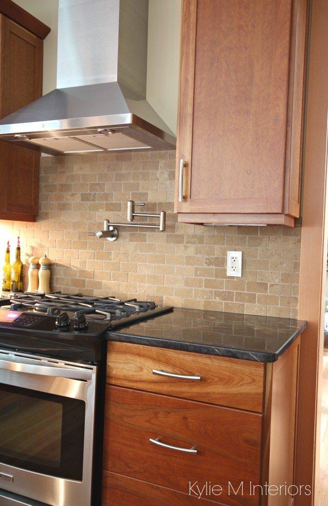 Natural cherry cabinets, travertine tile backsplash, black ... on Backsplash Black Granite Countertops  id=74461