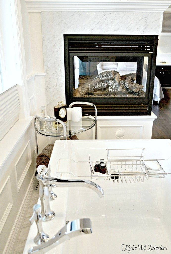 Gas Fireplace In Ensuite Bathroom With Marble Surround And