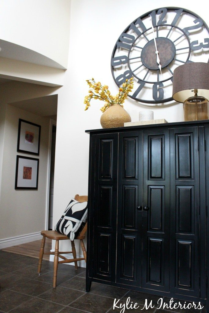 Entryway And Hallway Door Removed With Large Clock Black
