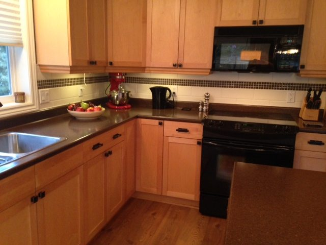 Our Kitchen Makeover - No More Maple! on What Color Backsplash With Maple Cabinets  id=97709