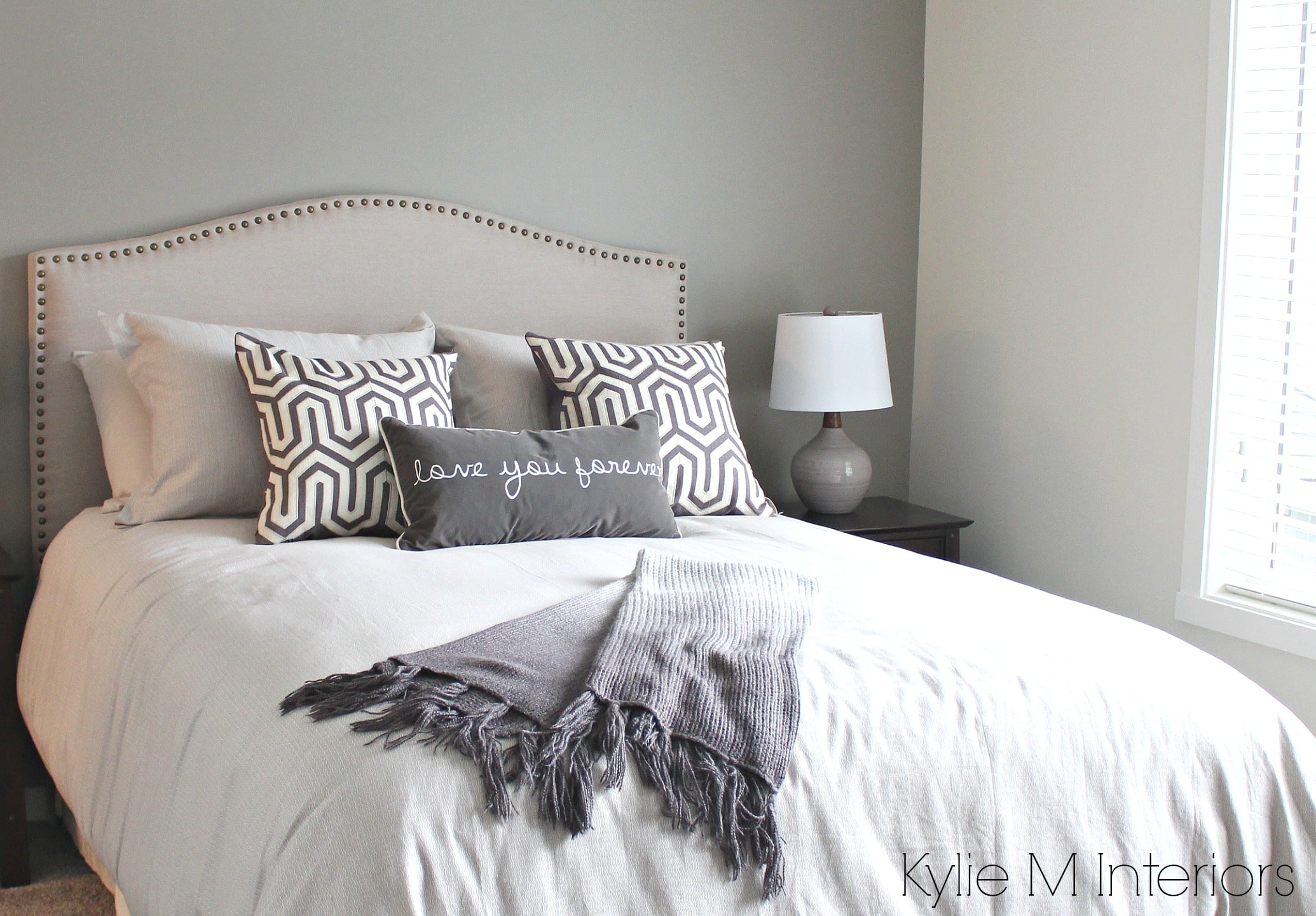 Bedroom With South West Exposure Painted In Gray To Accommodate For Natural Light Sherwin