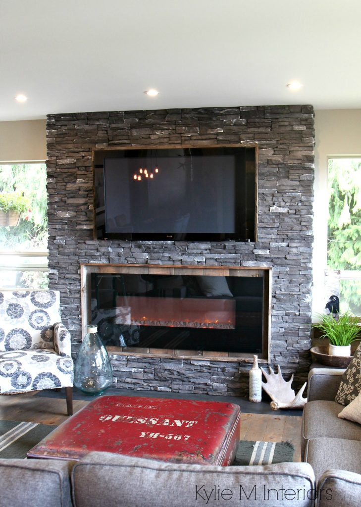 Rustic Ledgestone Fireplace With Reclaimed Wood Surround And TV On Top Hunting Inspired Decor