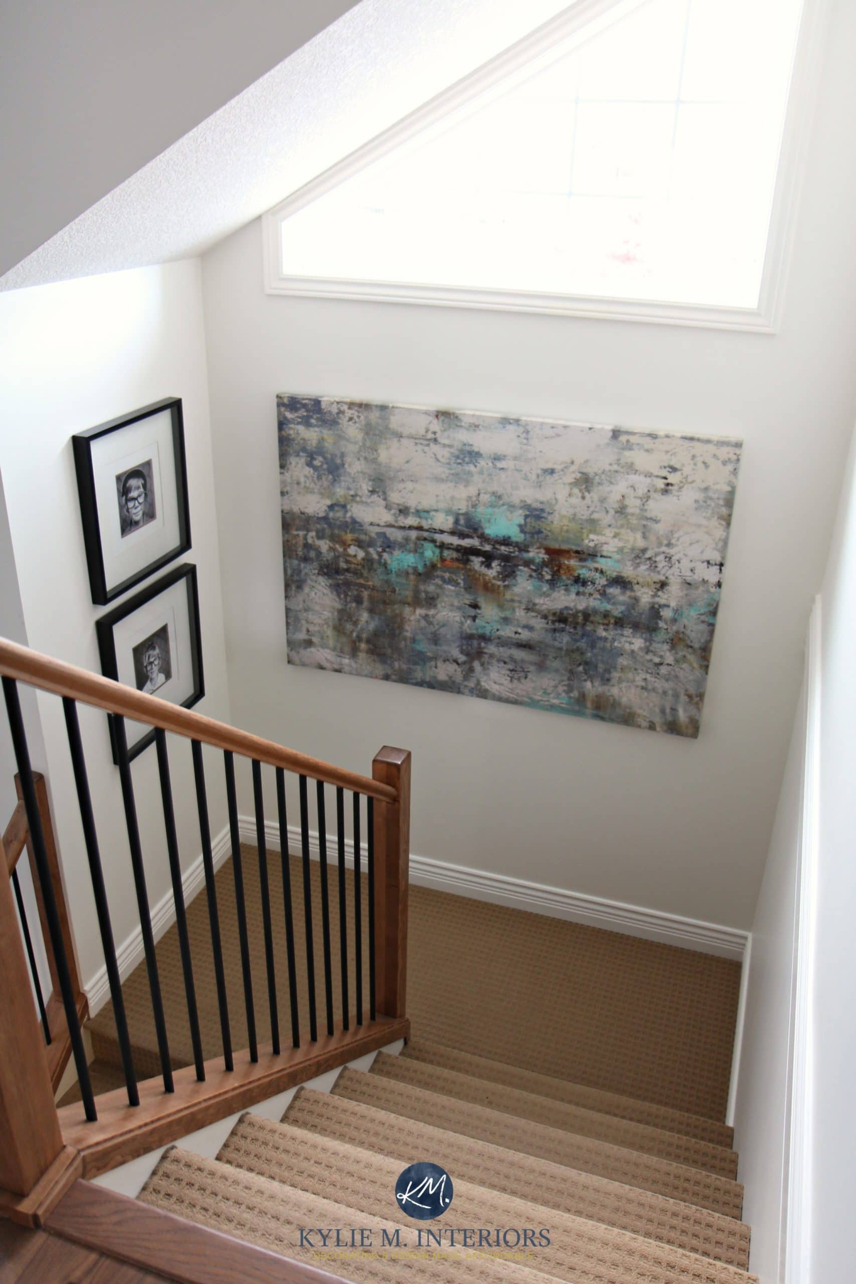Stairwell With Beige Carpet Wood And Metal Railing And