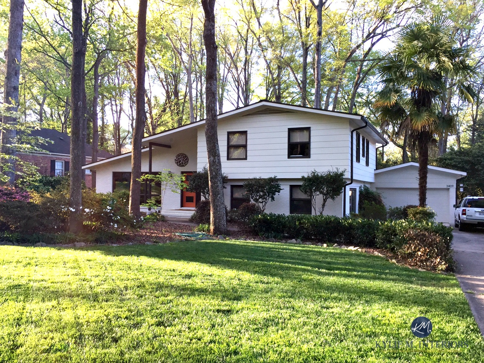 Exterior Split Level Home With Painted Brick Mid Century
