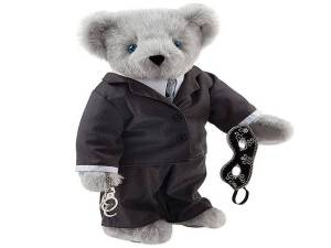 A picture of a teddy bear dressed up as Christian Grey from the movie '50 Shades of Grey'.