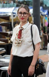 Modest, professional, gender-neutral outfits with signature items such as small silk scarves and thickly-rimmmed glasses will be featured in fashion this fall.