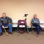 Candidates Jody Hall and Scott Orenstein next to the LAKE video camera, in Lcc retreat, by Gretchen Quarterman, for Lowndes Area Knowledge Exchange (LAKE), 27 February 2014