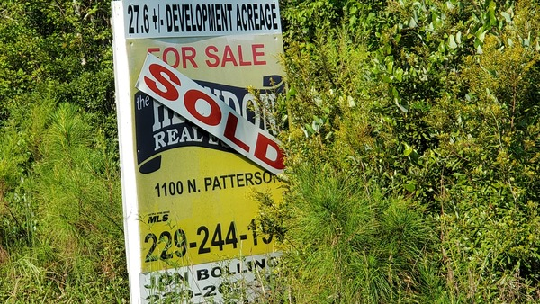 [Sold sign, 27.6+/- acres]