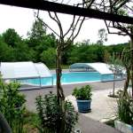 Ouverture centrale abri de piscine bas ARTECH Fabricant Installateur