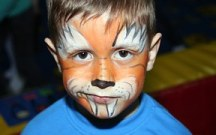 A boy with face painted