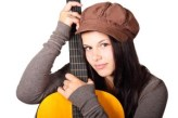 woman hugging guitar