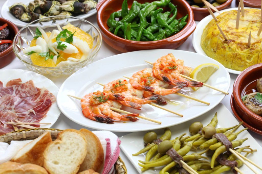 Eating as many tapas as you can possibly try is among the top most important things to do when you travel to Barcelona Spain. Fall in love with Spanish food.  #barcelona #travel