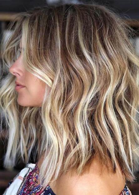 Want to learn how to get perfect mermaid hair for summer? Beachy waves hair is a favorite among women. Find the best beach hair products and tools for beachy waves hairstyles, such as hair texturizer, hair spray, and dry shampoo. What is the best hair wand for lob styling and a perfect hair straightener to get loose wave hair. #beachhair #beachywaveshair #beachairwave #mermaidhair #summerhairstyles